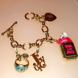 Juicy couture gold tone bracelet with charms